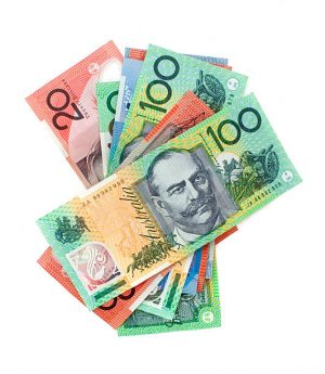 A pile of Australian banknotes isolated on a white background.